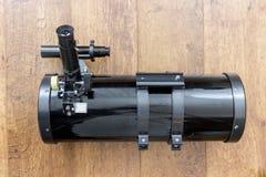Telescope. Black Newtonian reflector telescope side view royalty free stock image