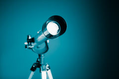 Telescope on blue background Stock Photography