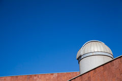 Telescope on a blue sky Stock Photo