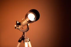 Telescope on brown background Stock Image