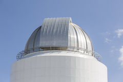 Telescope buildings dome. Telescope building dome at the top of the mountain Royalty Free Stock Image