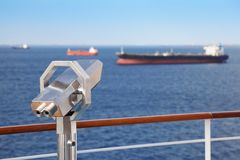 Telescope on deck of cruise ship. Royalty Free Stock Photo