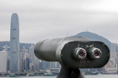Telescope directed on Hong Kong. Coin-operated telescope directed on Hong Kong Royalty Free Stock Images