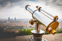 Telescope directed towards the city of Lyon, France Stock Photo