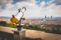 Telescope directed towards the city of Lyon, France Stock Photos
