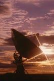 Telescope dish against sunset Royalty Free Stock Photo