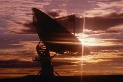 Telescope dish against sunset Royalty Free Stock Image