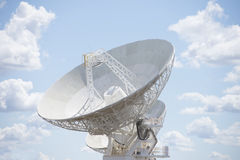 Telescope dish with blue sunny sky Stock Photos
