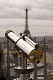 Telescope With Effel Tower. A bright and shiny telescope on the Arc de Triomphe in Paris with the Eiffel Tower in the background royalty free stock photos