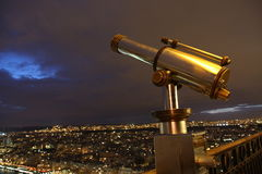 Telescope on the Eiffel tower Royalty Free Stock Image