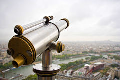 Telescope on Eiffel tower. Using a telescope you can overlook the whole panoramic view of Paris cityscape, so splendid & cheeful Stock Photography