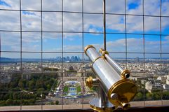 Telescope at the Eiffel Tower overlooking Paris Royalty Free Stock Photo