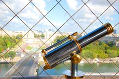Telescope on the Eiffel Tower Royalty Free Stock Images