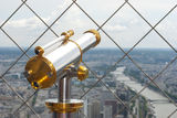 Telescope on Eiffel tower Royalty Free Stock Images