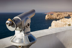 Telescope at lighthouse Sao Vicente, Sagres Portugal. Telescope at lighthouse Sao Vicente with rocks and cliffs at the ocean, Sagres Portugaln stock photos
