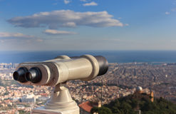 Telescope look at the city Stock Image