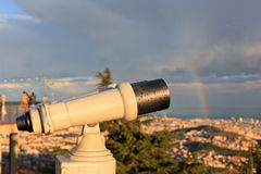 Telescope look at the city Royalty Free Stock Photos