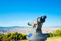 Telescope look at the city Barcelona Royalty Free Stock Photography