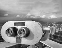 Telescope looking at city skyscrapers Royalty Free Stock Image