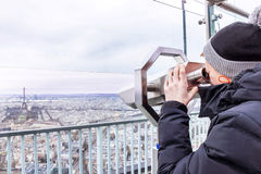 Telescope of Montparnasse. Boy is looking to Eiffel tower. Stock Photography