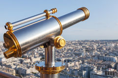 Telescope mounted on the railings of Eiffel Tower in Paris Stock Photography