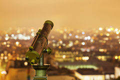 Telescope with a night view over Paris Stock Photo