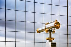 Telescope at observation deck overlooking for Paris. Vintage coin operated binocular overlooking for Paris from top of Eiffel Tower. Monocular telescope at royalty free stock photos