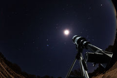Telescope over night sky with stars and moon Stock Photos