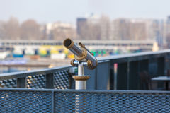 Telescope overlooking for city streets from above Stock Photo
