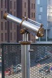 Telescope overlooking for city streets from above Stock Photos