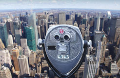 Telescope overlooking Manhattan skyline Royalty Free Stock Images
