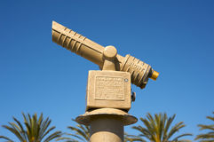 Telescope and palm trees. Telescope with palm trees and a clear sky in the background Royalty Free Stock Photography