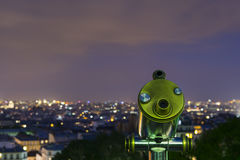 Telescope and panoramic view at the city of Paris Stock Images
