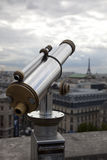 Telescope in Paris. Telescope on the roof in Paris with the Eiffel Tower in background Royalty Free Stock Photo