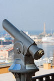 Telescope payment. Telescope pending payment of tourists interested and curious Royalty Free Stock Image