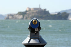 Telescope pointed on Alcatraz Island. Coin operated telescope pointed in Alcatraz Island visible in background Royalty Free Stock Photos