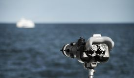 Telescope pointed at ship. Far at the sea Stock Photography