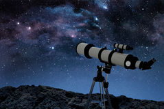 Telescope on rocky ground Stock Photography