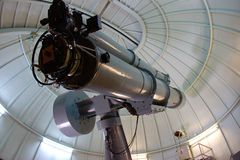 Antique telescope at an observatory. Telescope from the 1950`s at an observatory. Vintage technology
