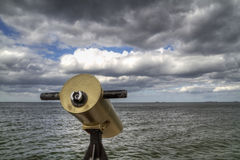 Telescope on the sea coast Royalty Free Stock Photos