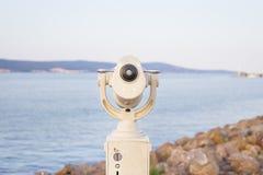 Telescope on the sea-summer, sun, sea, beach. Telescope on the sea-summer, sun, sea beach Stock Image