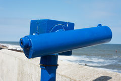 Telescope on seaside promenade. Royalty Free Stock Images