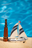 Telescope and ship next to the pool Stock Photography