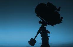 Telescope silhouette at sunrise #2. Schmidt-Cassegrain telescope silhouette at sunrise stock image