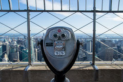 Telescope to observe the city. New York City, USA - August 4, 2013:view of new york city from the top of the Empire State Building.there are telescopes to get a Stock Photography