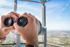 Telescope on the tower. Man& x27;s hands, holding telescope on top of Avala mountain observation tower deck, Belgrade, Serbia. Close up Stock Photography