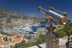 Telescope with view of Monte-Carlo and harbor in the Principality of Monaco, Western Europe on the Mediterranean Sea Stock Photo