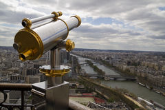 Telescope with view of Paris. In background Stock Photography
