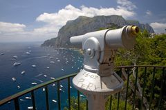Telescope viewer of City of Capri, an Italian island off the Sorrentine Peninsula on the south side of Gulf of Naples, in the regi Royalty Free Stock Images