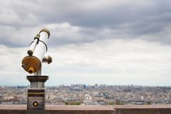 Telescope viewer and city skyline at daytime. Royalty Free Stock Photography